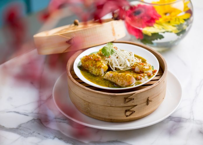 Steamed spicy Betki with mango and Indian mustard sauce